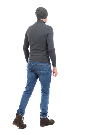 Back view of going  handsome man. walking young guy .