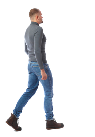 Back view of going  handsome man. walking young guy . Rear view people collection.  backside view of person.  Isolated over white background. A man in a gray sweater passes by.