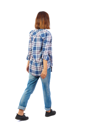 back view of walking  woman. beautiful blonde girl in motion.  backside view of person.  Rear view people collection. Isolated over white background. A girl wearing a blue checkered shirt leaves the frame