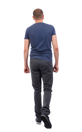 Back view of going  handsome man. walking young guy . Rear view people collection.  backside view of person.  Isolated over white background. a guy in trousers and a blue T-shirt goes away