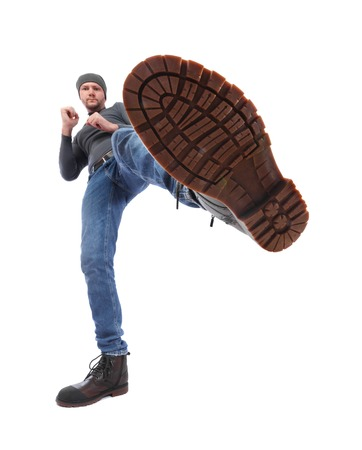The man is kicking. Foot with a shoe close-up. Corrugated sole of the boot from the bottom up Standard-Bild