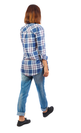 back view of walking  woman. beautiful blonde girl in motion.  backside view of person.  Rear view people collection. Isolated over white background. The girls blue checkered shirt goes sideways.