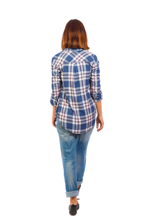 back view of walking  woman. beautiful blonde girl in motion.  backside view of person.  Rear view people collection. Isolated over white background. The girl wears a checkered shirt in the distance.