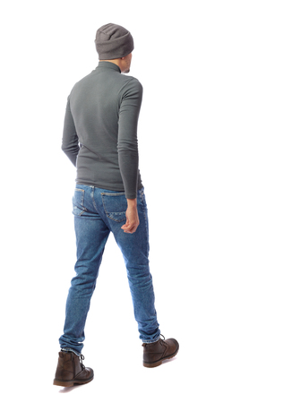 Back view of going  handsome man. walking young guy . Rear view people collection.  backside view of person.  Isolated over white background. A man in a gray sweater is passing by.