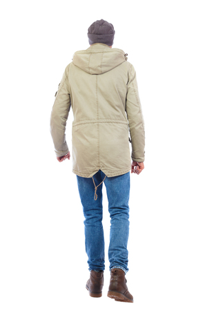 Back view of going  handsome man. walking young guy . Rear view people collection.  backside view of person.  Isolated over white background. A guy in a jacket and a hat goes away