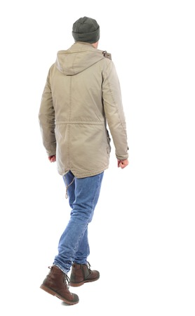 Back view of going  handsome man. walking young guy . Rear view people collection.  backside view of person.  Isolated over white background. The guy in the jacket and the hat goes sideways