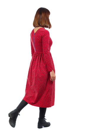 back view of walking  woman. beautiful girl in motion.  backside view of person.  Rear view people collection. Isolated over white background. A woman in a long red dress goes sideways