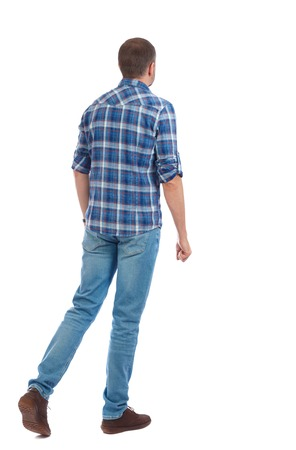Back view of going  handsome man. walking young guy . Rear view people collection.  backside view of person.  Isolated over white background. The man in a blue shirt goes sideways.