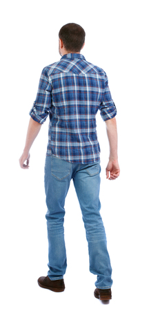 Back view of going  handsome man. walking young guy . Rear view people collection.  backside view of person.  Isolated over white background. a man in a blue shirt goes sideways.