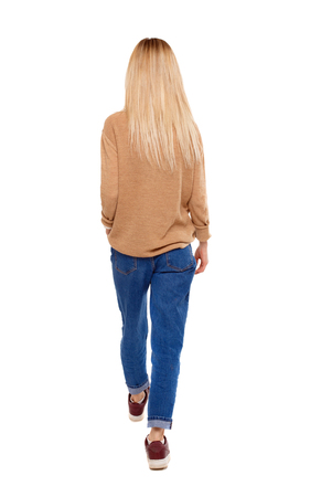 back view of walking woman. beautiful girl in motion. backside view of person.  Rear view people collection. Isolated over white. Blonde in sneakers goes into the distance