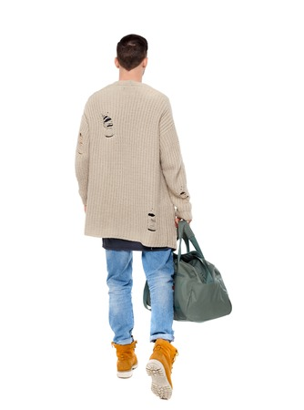 back view of walking  man  with green bag. backside view of person.  Rear view people collection. Isolated over white background. Brunette in warm clothes hurries on his flight