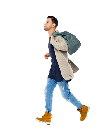 Side view of a running man with a green bag. Side view people collection. Isolated over white background. The guy in the sweater runs late