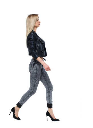 side view of walking woman. beautiful girl in motion. backside view of person.  Rear view people collection. Isolated over white. thoughtful blonde hurrying somewhere