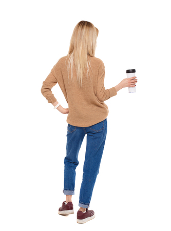 Back view of walking  woman  with coffee cup and backpack. backside view of person.  Rear view people collection. Isolated over white background.  A young girl drinks a large serving of coffee