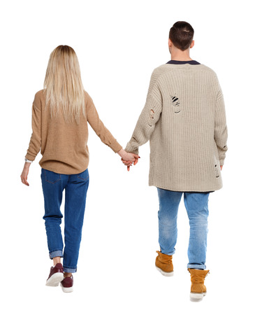 Back view of going couple. walking friendly girl and guy holding hands. Rear view people collection. backside view of person. Isolated over white background. Husband and wife are walking hand in hand.