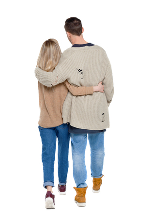 Back view of going couple. walking friendly girl and guy holding hands. Rear view people collection. backside view of person. Isolated over white background. Husband and wife walking around embracing