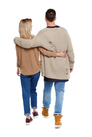 Back view of going couple. walking friendly girl and guy holding hands. Rear view people collection. backside view of person. Isolated over white background. Husband and wife are walking close to each other.