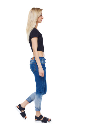 side view of walking woman. beautiful girl in motion. backside view of person.  Rear view people collection. Isolated over white. Blonde in the short topic slowly passes by