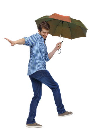 Side view of a man balancing with an umbrella. The guy jumps over a puddle. side view of person.  Rear view people collection. Isolated over white background.