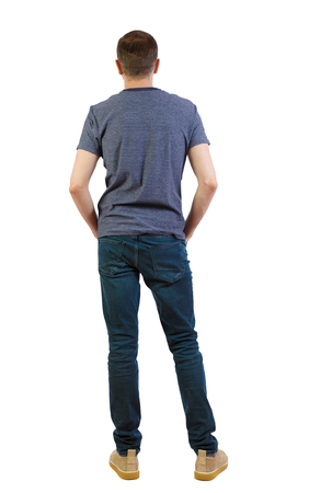 Back view of man in dark jeans. Standing young guy. Rear view people collection. backside view of person. Isolated over white background. A guy in summer clothes is standing with his back in his jeans.