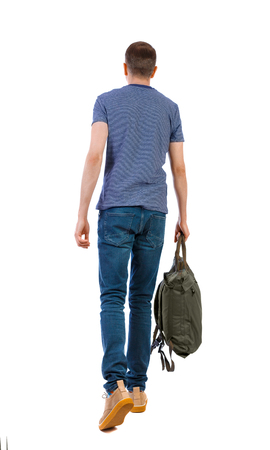 back view of walking  man  with green bag. backside view of person.  Rear view people collection. Isolated over white background. The guy in the striped T-shirt is carrying a backpack Stock Photo