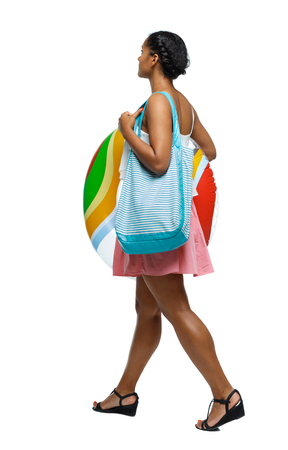Side view of an African-American with a beach bag that goes to the side. backside view of person.  Rear view people collection. Isolated over white background. Black girl goes to the beach