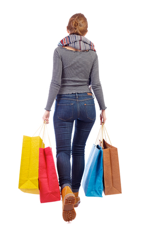 back view of woman in striped T-shirt with shopping bags . beautiful brunette girl in motion.  backside view of person.  Rear view people collection. Isolated over white background. Blonde in a shirt with paper bags