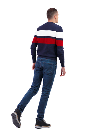 Back view of going  handsome man iin a multi-colored sweater. walking young guy . Rear view people collection.  backside view of person.  Isolated over white background. Stock Photo