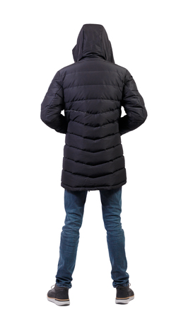 Back view of a stylish man in a knitted sweater. Rear view people collection.  backside view of person.  Isolated over white background. A man in jeans is wearing a jacket hood.