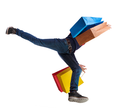 Bottom view of a man running with shopping bags. Guy in motion.  backside view of person.  Rear view people collection. Isolated over white background. Banque d'images