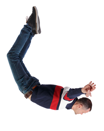 Side view of man in zero gravity or a fall. guy is flying, falling or floating in the air. Side view people collection. side view of person. Isolated over white background. A man falls down.