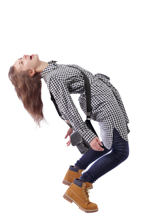 Side view of a woman with a purse dancing ballet. The girl is balancing. Rear view people collection.  backside view of person.  Isolated over white background. Joyful girl with a bag strongly deviated back
