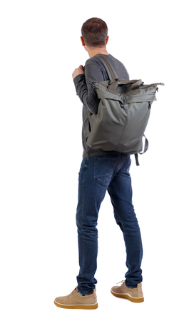 Back view of a man with a green bag.  backside view of person.  Rear view people collection. Isolated over white background. A man with a big green backpack on his shoulder is looking forward. Stock Photo