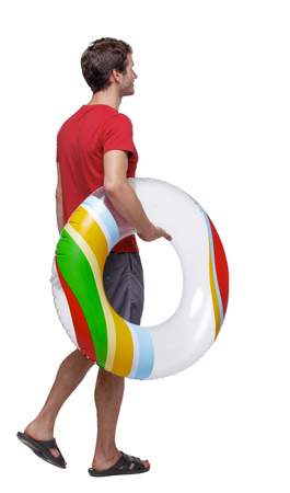 Side view of man with a beach bag that goes to the side. backside view of person.  Rear view people collection. Isolated over white background.  Beach tourist in flip-flops and shorts carries a rubber ring.