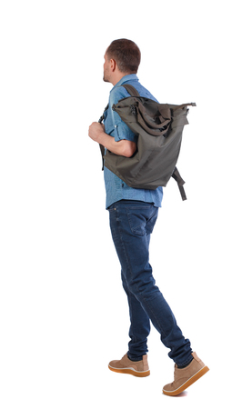 back view of walking  man  with green bag. backside view of person.  Rear view people collection. Isolated over white background. A stylish man in a blue shirt carries a green bag on his shoulder.