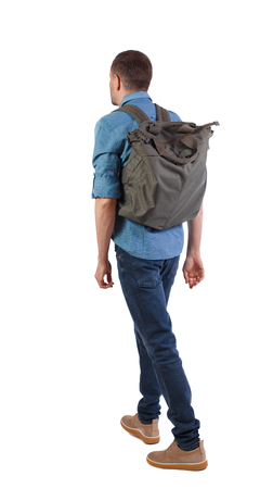 back view of walking  man  with green bag. backside view of person.  Rear view people collection. Isolated over white background. A man in yellow shoes carries a large backpack on his back.