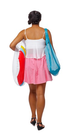 Back view of an African-American with a beach bag that goes to the side. backside view of person.  Rear view people collection. Isolated over white background. The girl goes to the beach with things.