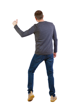 Back view of a man showing thumb up. Rear view people collection.  backside view of person.  Isolated over white background. The guy catches a taxi with his hand out.