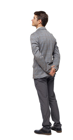 Back view of Business man looks.  Rear view people collection.  backside view of person. Isolated over white background. The guy in the suit with his hands folded behind him looks up.