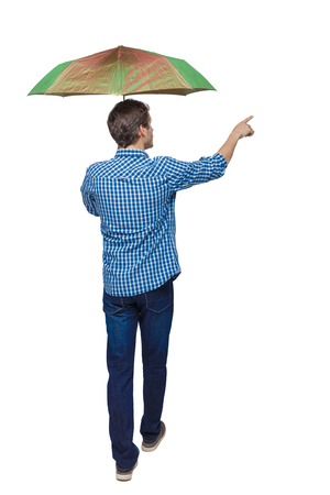 Back view of a man who goes under an umbrella and points with his hand. backside view of person. Rear view people collection. Isolated over white background.