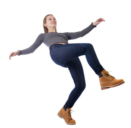 Balancing young woman.  or dodge falling woman. Rear view people collection.  backside view of person.  Isolated over white background. Happy girl falls back.