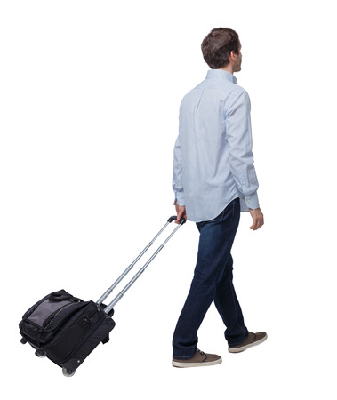 back view of walking  business man  with suitcase.  brunette guy in motion. backside view of person.  Rear view people collection. Isolated over white background. The young traveler goes into the distance.