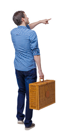 Back view of pointing man walking with a picnic bag. backside view of person.  Rear view people collection. Isolated over white background. A guy at a picnic looking at the sights.