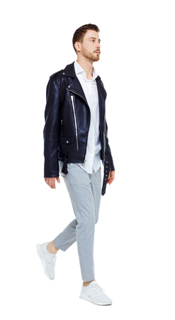 Front view of going  handsome man in a leather jacket and trousers. walking young guy . Front view people collection.  Isolated over white background.