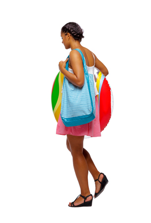 Side view of an African-American with a beach bag that goes to the side. backside view of person.  Rear view people collection. Isolated over white background. black girl goes to the beach.