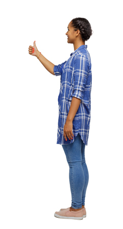 Side view of a black woman showing thumb up. Rear view people collection. backside view of person. Isolated over white background. African American smiles. Reklamní fotografie