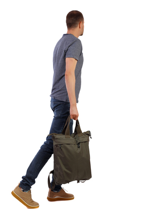 Side view of walking  man  with green bag. backside view of person.  Rear view people collection. Isolated over white background. student passes by holding the bag in his hand. Imagens