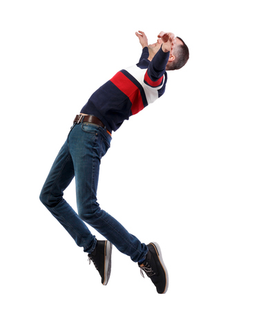 Side view of man in zero gravity or a fall. guy is flying, falling or floating in the air. Side view people collection.  side view of person.  Isolated over white background. A man in a striped sweater is balancing on the tips of his toes, strongly leaning back. Standard-Bild