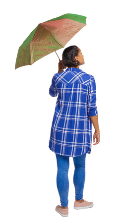 back view of a dark-skinned girl in a shirt under an umbrella. backside view of person.  Rear view people collection. Isolated over white background. Stock Photo