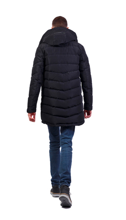 Back view of going  handsome man in jeans and winter jacket.  walking young guy . Rear view people collection.  backside view of person.  Isolated over white background. A serious man in a warm black jacket goes into the distance.